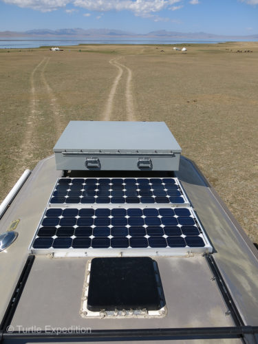 Two BP85 solar panels on the roof run through a Blue Sky Energy Solar Boost 3000i controller.