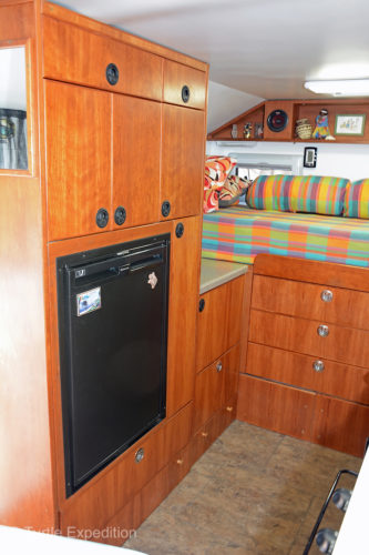 Next to the entry door is the refrigerator cabinet purposely positioned over the wheel well.