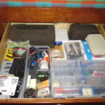 The top drawer is used for general stationary; batteries, chargers, paper, a portable printer and a portable photo printer.