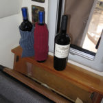 Old socks placed around wine bottles makes the compartment behind a seat a wine cellar when it's not filled with dirty clothes.
