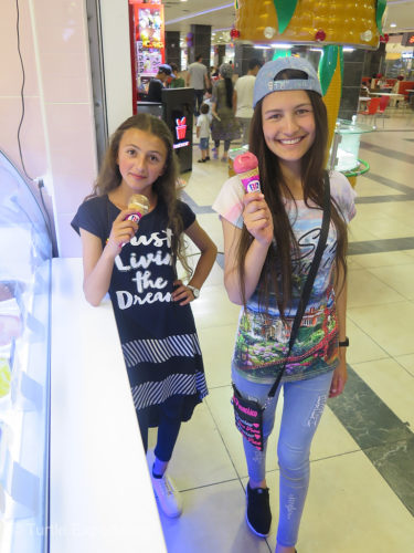 During a visit to Tajikistan's capital she and her friend enjoyed city life with ice cream, pizza, malls, escalators, movies and a beauty parlor. It was a new world!