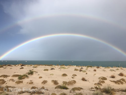 A full double rainbow frames the shrimp boats south of San Felipe as a storm approaches.