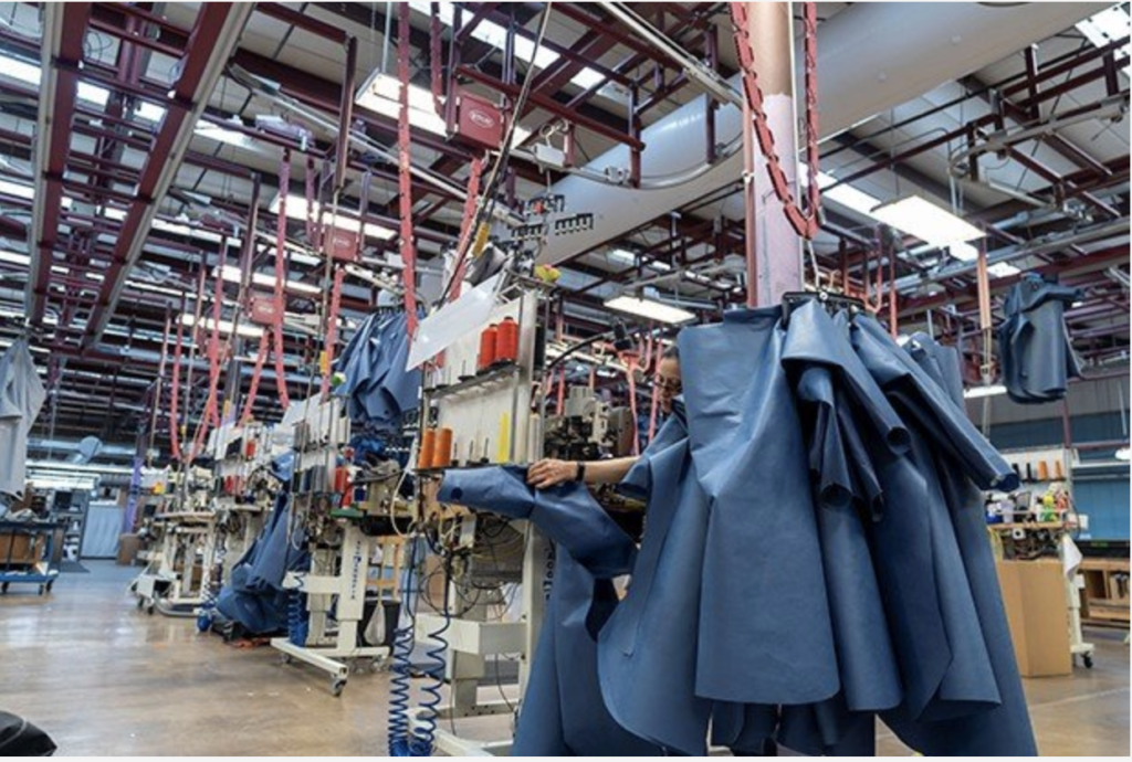At the Covercraft manufacturing facilities employees are busy sewing protective gear for medical personnel and first responders. © Covercraft