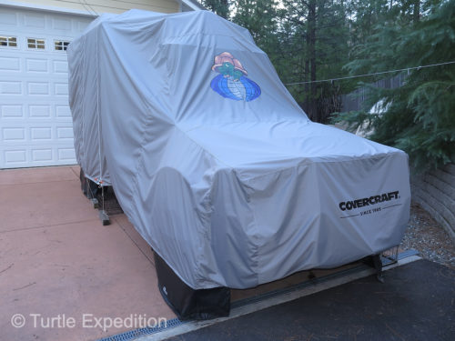 "The Turtle V is ""expedition ready"", safely waiting under its Covercraft blanket, patiently tapping fingers on the driveway and waiting for its next adventure."